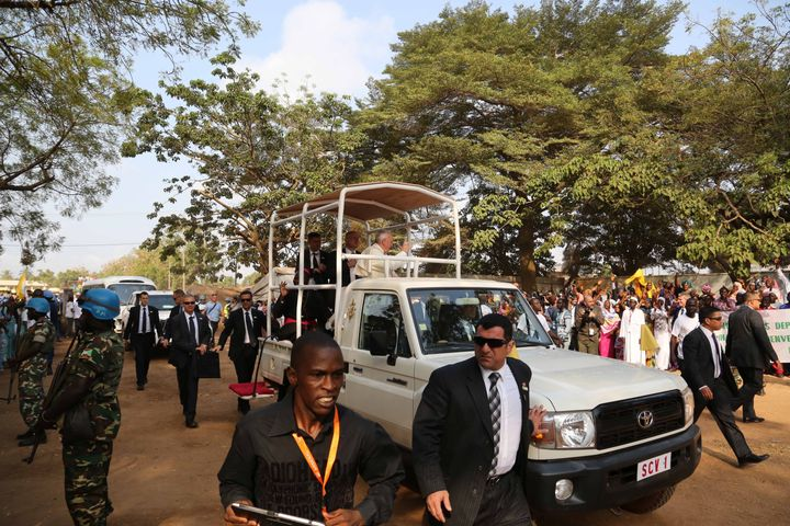 Pope Francis waves to faithful from a car during his visit to Central Mosque in Bangui, Central African Republic on November 30, 2015.