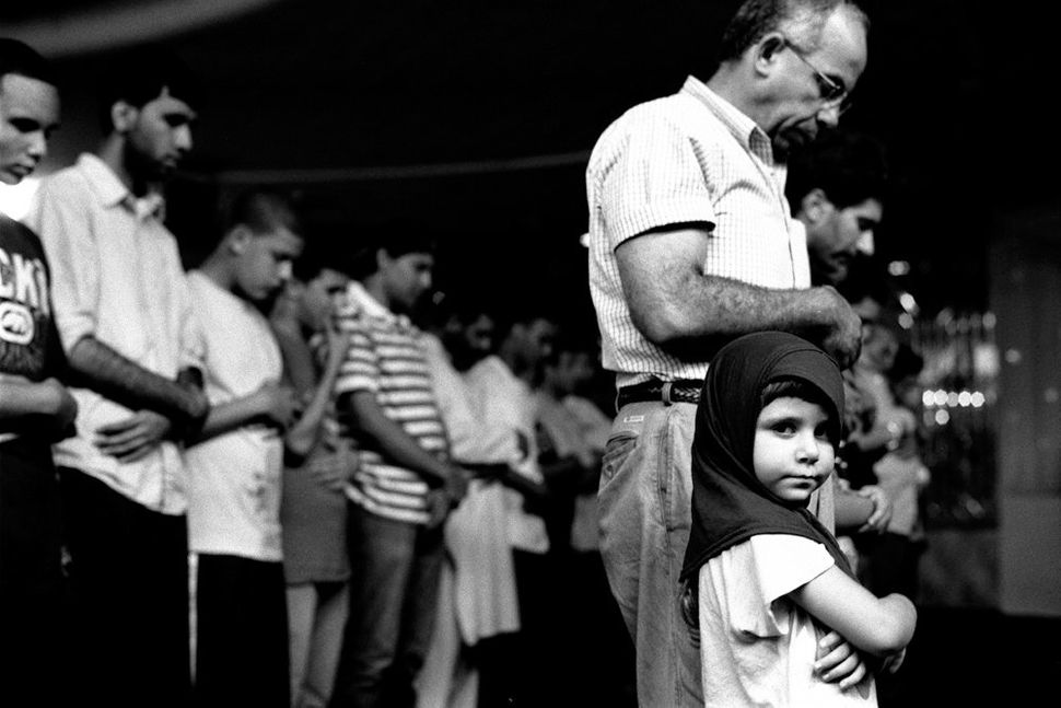 Young Girl at Prayers with her Father, Muslim AmericanSociety, Brooklyn, NY 2010