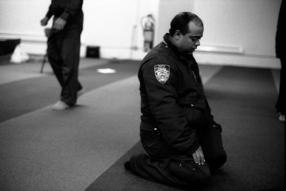 NYPD Traffic Officer at Prayer, Park 51, Manhattan, NY 2012