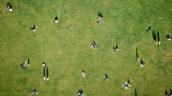 Aerial of people walking, lying down and on a picnic in New York's Central Park.