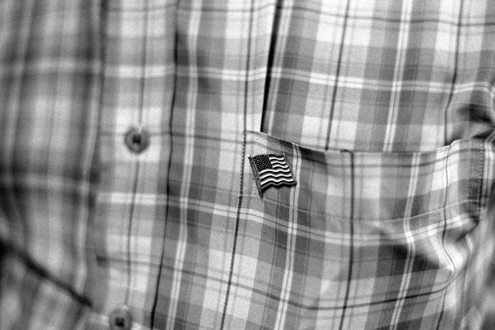American Flag Pin on Man Coming to Prayers, MuslimAmerican Society, Brooklyn, NY 2010