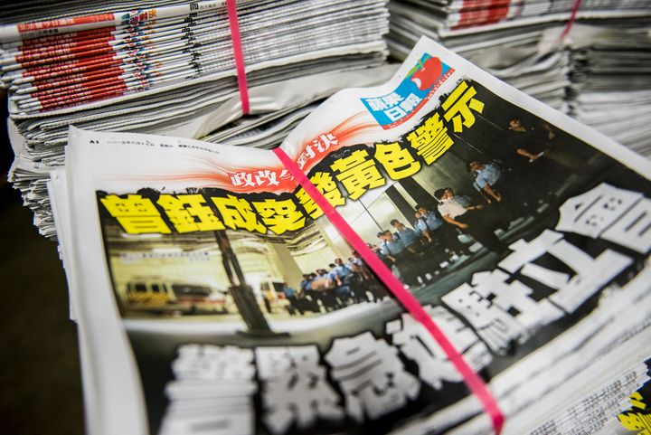 Copies of the Apple Daily newspaper sit stacked at the company's printing facility in Hong Kong.