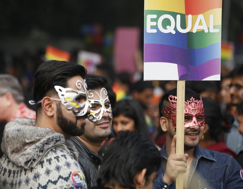 NEW DELHI, INDIA - NOVEMBER 29: LGBT rights activists hold placards during Delhi Queer Pride March from Barakhamba Road to Ja