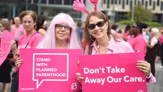 MANHATTAN, NEW YORK CITY, NEW YORK, UNITED STATES - 2015/09/29: Activists with signs and costumes. Activists and directors of Planned Parenthood, NYC, gathered in Foley Square along NYC first lady Chirlane McCray and elected representatives to demonstrate support for the organization. (Photo by Andy Katz/Pacific Press/LightRocket via Getty Images)