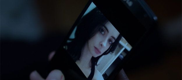 Kilgrave looks at a selfie sent by Jessica Jones.
