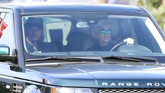 Gwen Stefani drives Blake Shelton to work on Monday morning.  Gwen and Blake left her home early on Monday morning and headed top the studios to record 'The Voice'.