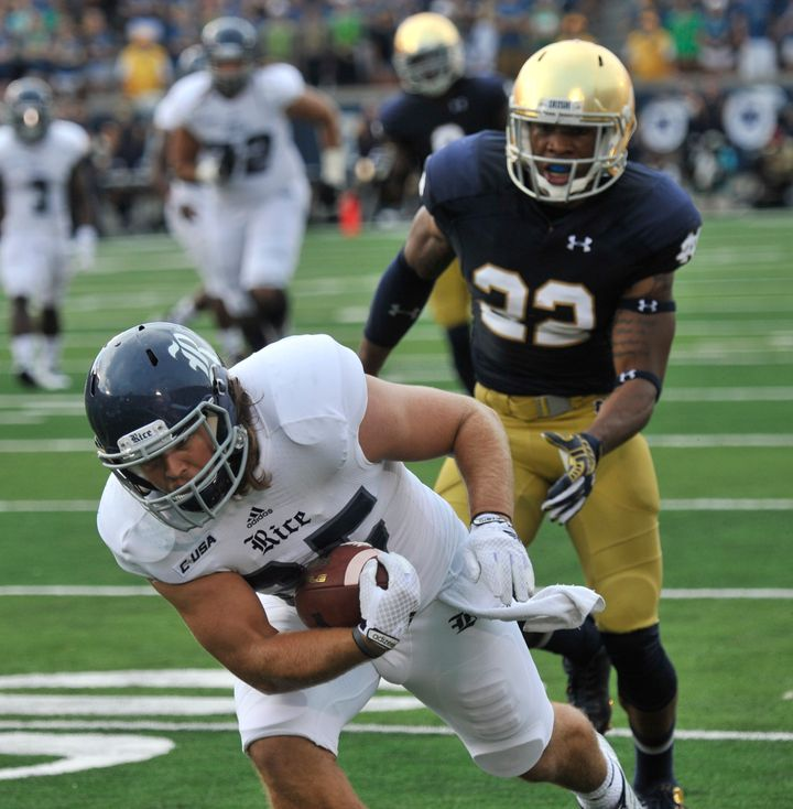 Notre Dame linebacker Joe Schmidt tackles Rice running back Luke Turner during a NCAA football game with Rice Saturday, Aug.