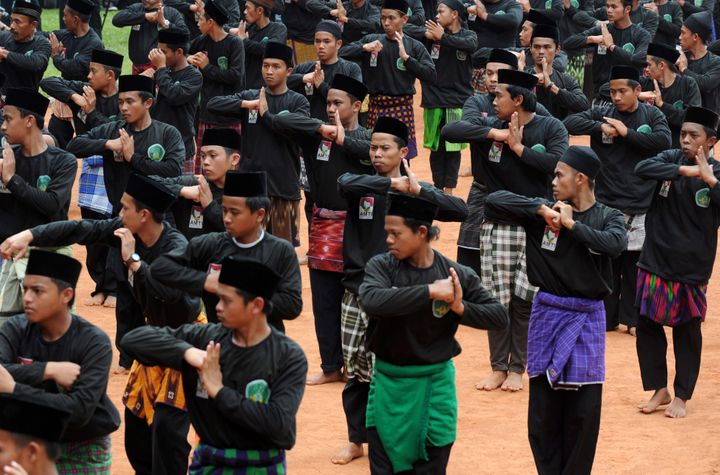 Members of the Nadlatul Ulama organization perform a traditional Indonesian martial art during a ceremony to mark the 85