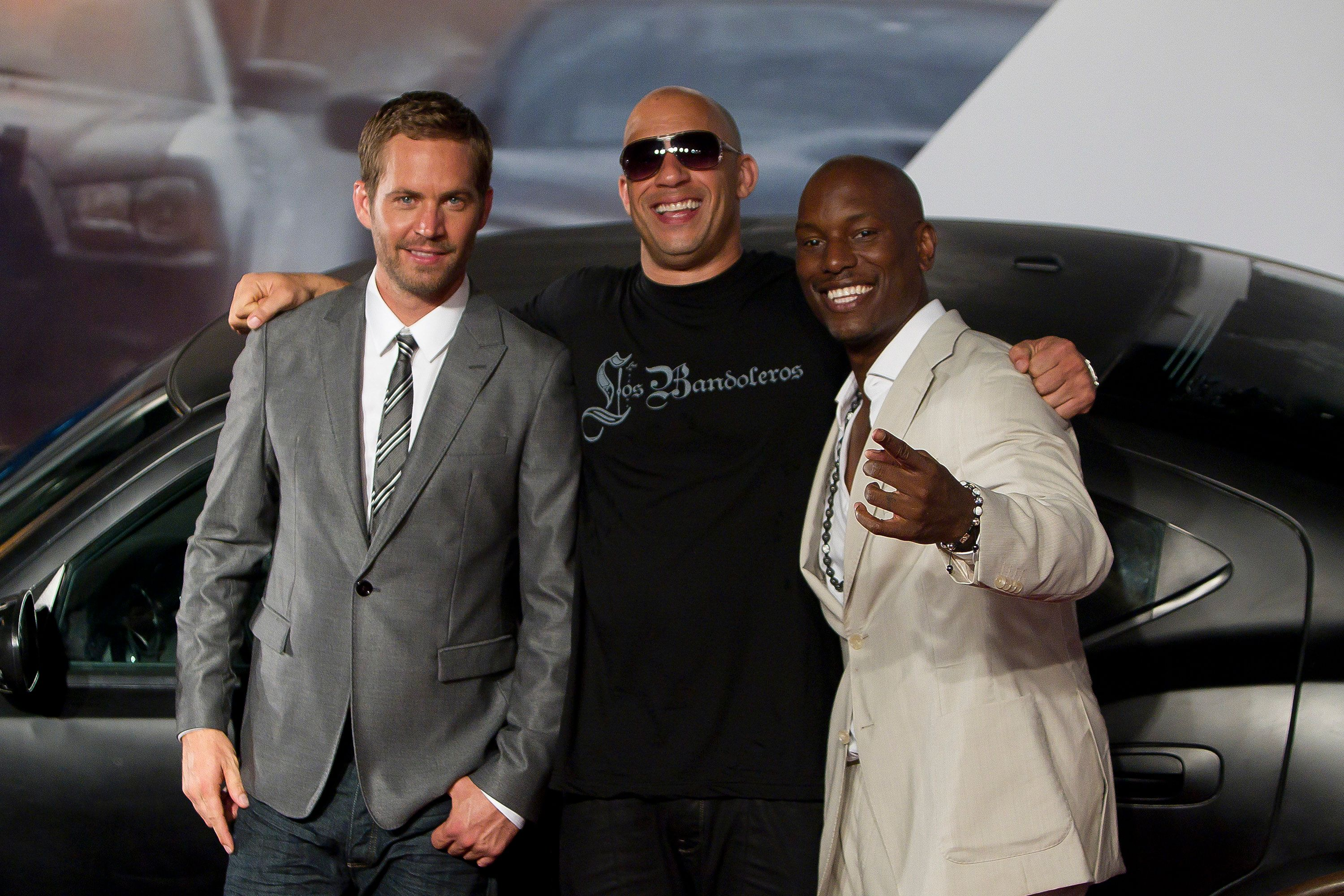 RIO DE JANEIRO, BRAZIL - APRIL 15:  (L-R) Paul Walker, Vin Diesel and Tyrese Gibson pose for photographers during the premiere of the movie 'Fast and Furious 5' at Cinepolis Lagoon on April 15, 2011 in Rio de Janeiro, Brazil. (Photo by Buda Mendes/LatinContent/Getty Images)