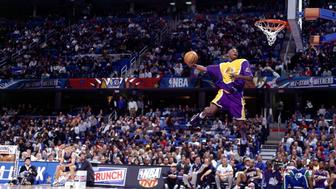 CLEVELAND - FEBRUARY 8:  Kobe Bryant #8 of the Los Angeles Lakers goes up for one of his slam dunks that won first place in the NBA All-Star Slam Dunk Contest at Gund Arena on February 8, 1997 in Cleveland, Ohio.  NOTE TO USER: User expressly acknowledges and agrees that, by downloading and or using this photograph, User is consenting to the terms and conditions of the Getty Images License Agreement.  Mandatory copyright notice: Copyright NBAE 2002  (Photo by Andrew D. Bernstein/NBAE/Getty Images)