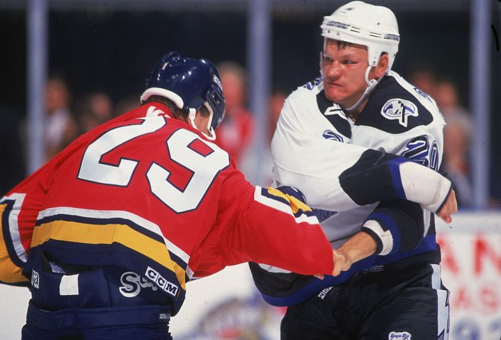Rudy Poeschek, right, during a fight in the 1990s. Poeschek is one of more than 80 former NHL players suing the league over c