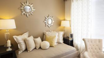 Bright den in home, with sunlight streaming in.