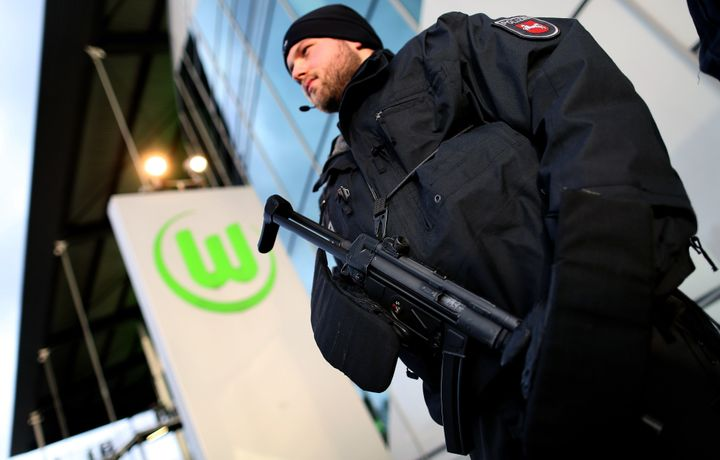 An armed German police officer guards the entrance of the Volkswagen Arena prior to a soccer match on November 21,