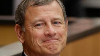 U.S. Supreme Court Chief Justice John Roberts smiles as he is introduced at the University of Nebraska Lincoln, in Lincoln, Neb., Friday, Sept. 19, 2014. Chief Justice Roberts said hes worried about growing partisanship in the judicial confirmation process and a public perception that the court is a political body. (AP Photo/Nati Harnik)