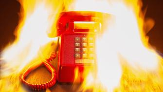 Old fashioned land line business phone on fire