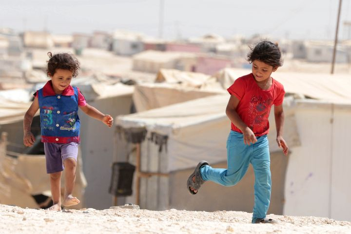 Young Syrian refugees play at the U.N.-run Zaatari camp, north-east of the Jordanian capital Amman, on Sept. 19, 2015.