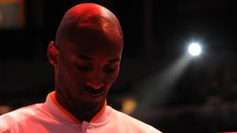 LOS ANGELES, CA - NOVEMBER 29:  Kobe Bryant #24 of the Los Angeles Lakers stands for the national anthem before the game against the Indiana Pacers on November 29, 2015 at STAPLES Center in Los Angeles, California. NOTE TO USER: User expressly acknowledges and agrees that, by downloading and/or using this Photograph, user is consenting to the terms and conditions of the Getty Images License Agreement. Mandatory Copyright Notice: Copyright 2015 NBAE (Photo by Andrew D. Bernstein/NBAE via Getty Images)