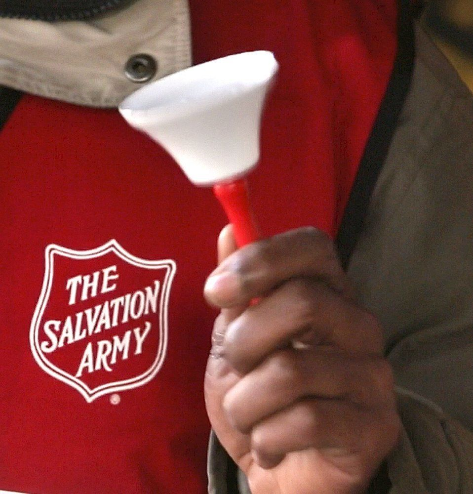 Danny Mitchell rings the bell at a Salvation Army donation kettle at Cabela's in Scarborough on Wednesday, November 21, 2012. Organizations like the Salvation Army rely on people being in a giving mood during the holiday season to help fund their programs for the needy year round.  (Photo by Gregory Rec/Portland Press Herald via Getty Images)