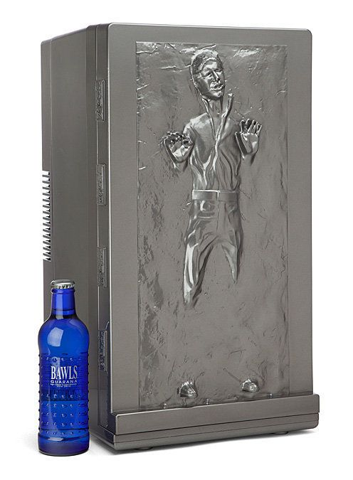 """<strong>Get the <a href=""""http://www.thinkgeek.com/product/1caf/"""">Han Solo Fridge from ThinkGeek</a>($149.99)</strong>"""
