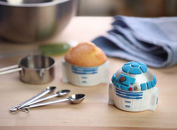 """<strong>Get the <a href=""""http://www.thinkgeek.com/product/huij/"""">R2-D2 Cupcake Pan from ThinkGeek</a>($19.99)</strong>"""