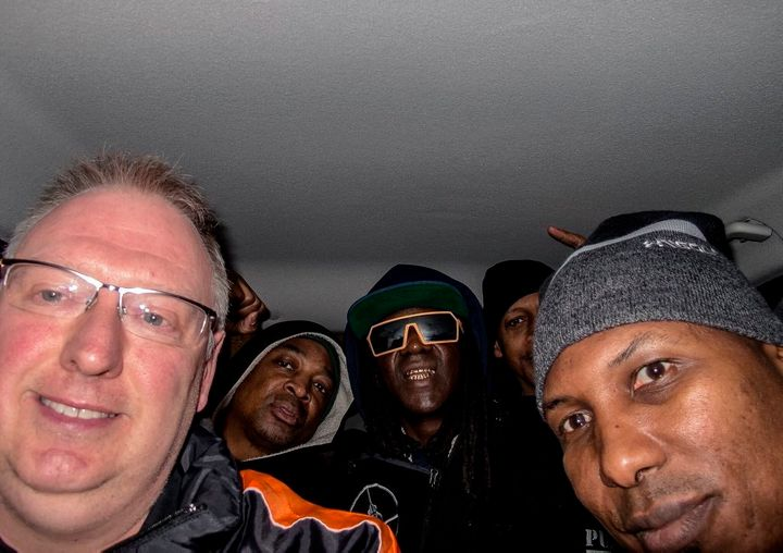 Kevin Wells is seen driving members of Pubic Enemy to their gig in Sheffield, England, on Saturday after their taxi bail