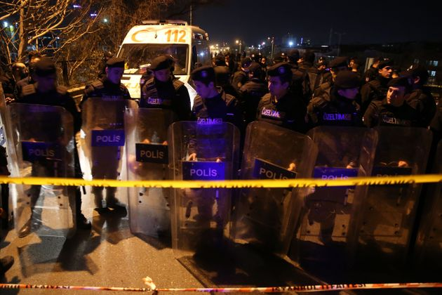 Turkish police officers stand guard around Bayrampasa Metro Station after a blast on Dec
