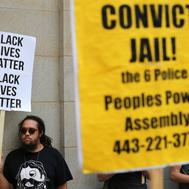 BALTIMORE, MD - SEPTEMBER 02:  A small and peacful group of demonstrators gather to protest in front of the Baltimore City Circuit Courthouse East where pre-trial hearings will be held for six police officers charged in the death of Freddie Gray September 2, 2015 in Baltimore, Maryland. Earlier this year Gray, 25, suffered a severe spinal cord injury while in police custody and later died. His funeral was followed by rioting, looting and arson.  (Photo by Chip Somodevilla/Getty Images)