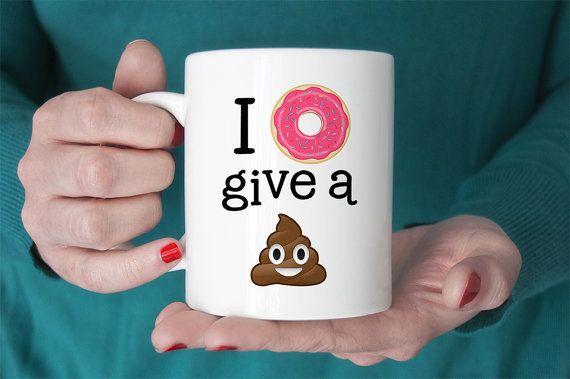 "<i>Buy it <a href=""https://www.etsy.com/listing/231863920/coffee-mug-i-donut-give-a-sht-poop-emoji"">here</a>.&nbsp;</i>"