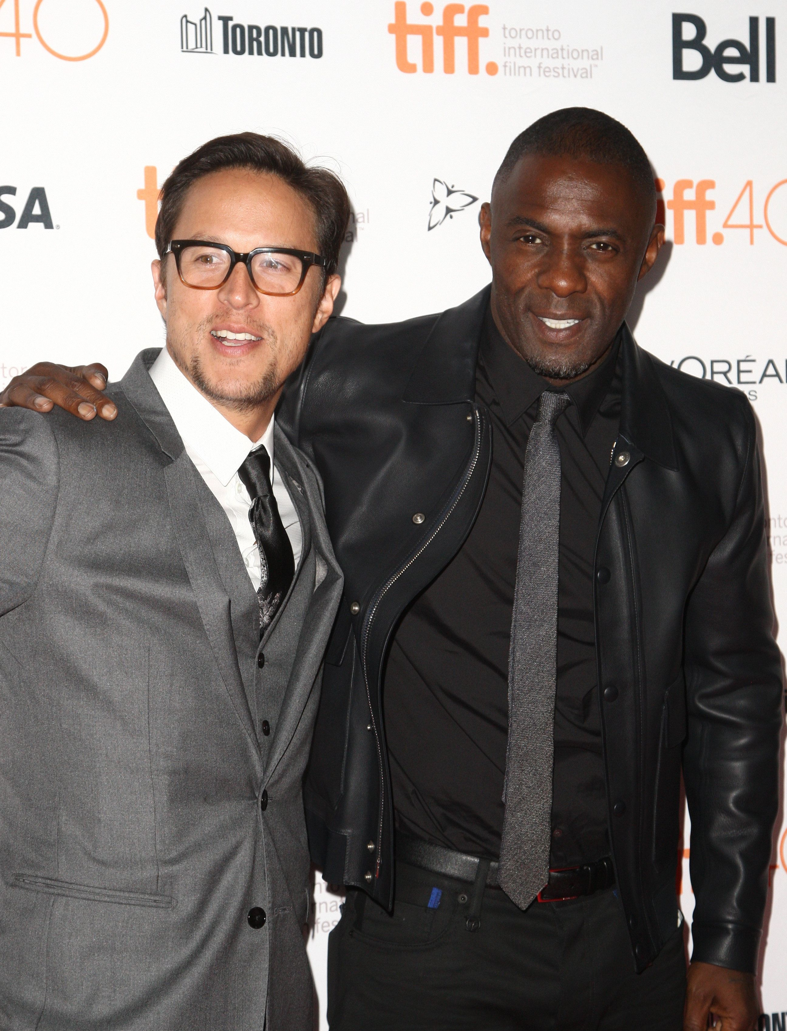 TORONTO, ON - SEPTEMBER 13: Director/screenwriter Cary Joji Fukunaga and actor Idris Elba attend the 'Beasts Of No Nation' premiere during the 2015 Toronto International Film Festival at Ryerson Theatre on September 13, 2015 in Toronto, Canada.  (Photo by Tommaso Boddi/Getty Images)