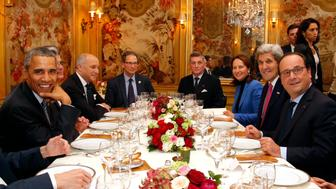 President Barack Obama (L) and French President Francois Hollande (R) have dinner at the Ambroisie restaurant in Paris, with Secretary of State John Kerry (2nd R), French Minister for Ecology, Sustainable Development and Energy Segolene Royal, (3rd R) and French Foreign Minister, Laurent Fabius, (2nd L) as part of the COP21 World Climate Change Conference in Le Bourget, north of Paris, on November 30, 2015. More than 150 world leaders are meeting under heightened security, for the 21st Session of the Conference of the Parties to the United Nations Framework Convention on Climate Change (COP21/CMP11), also known as 'Paris 2015' from November 30 to December 11. AFP PHOTO / POOL / THIBAULT CAMUS / AFP / POOL / THIBAULT CAMUS        (Photo credit should read THIBAULT CAMUS/AFP/Getty Images)