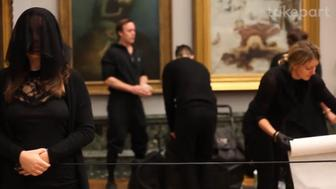 Activists take part in a protest inside the Tate museum.