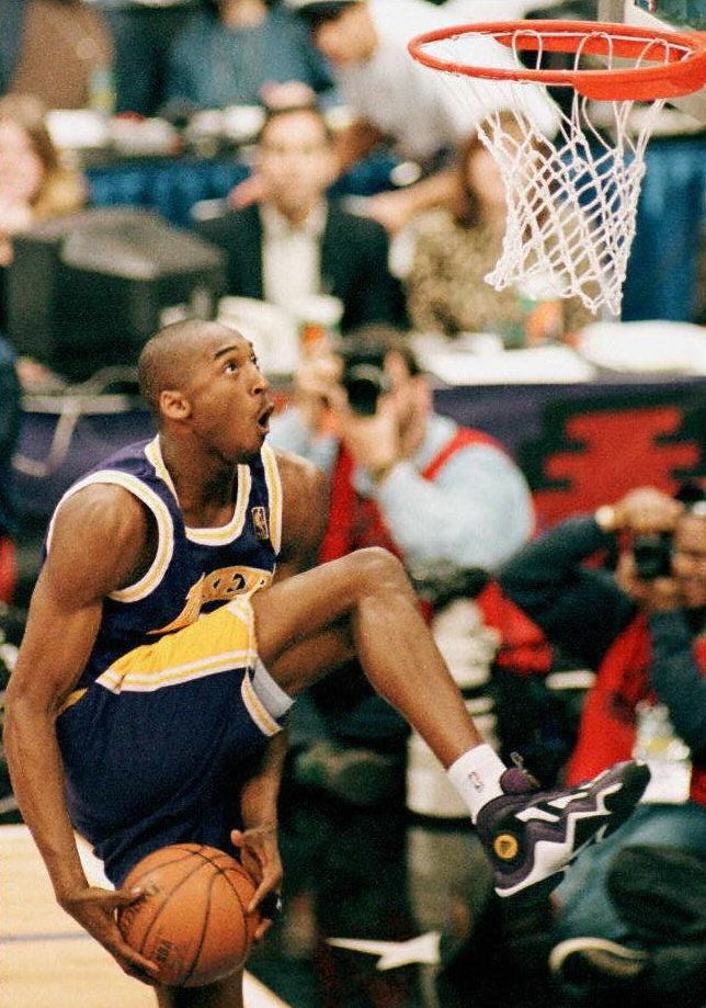 Bryanteyes the basket during the NBA Slam Dunk Contest at All-Star Weekend on Feb. 8, 1997. On that day, at age 18, Bry