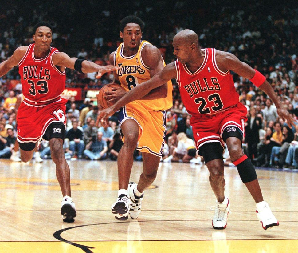Michael Jordan and Scottie Pippen try to stop Bryant as he leads a fast break in a Feb. 1, 1998, game between the Chicag