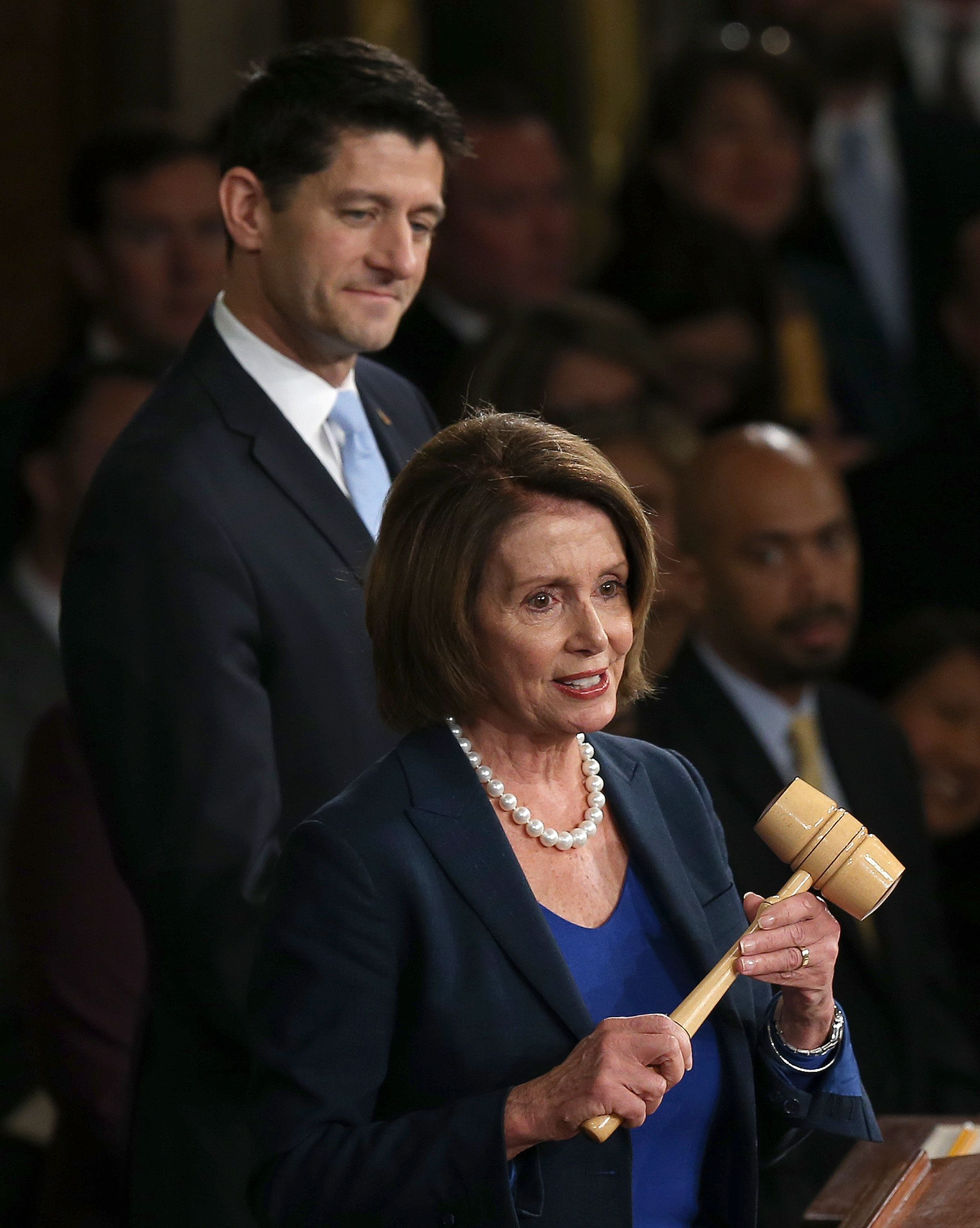 WASHINGTON, DC - OCTOBER 29:  House Minority Leader Nancy Pelosi (R) (D-CA) prepares to give the Speaker's gavel to Speaker of the House Paul Ryan (L) (R-WI)  after Ryan was elected to the leadership position October 29, 2015 in Washington, DC. The House elected Ryan (R-WI) as the 62nd Speaker of the House, replacing Rep. John Boehner (R-OH).  (Photo by Win McNamee/Getty Images)