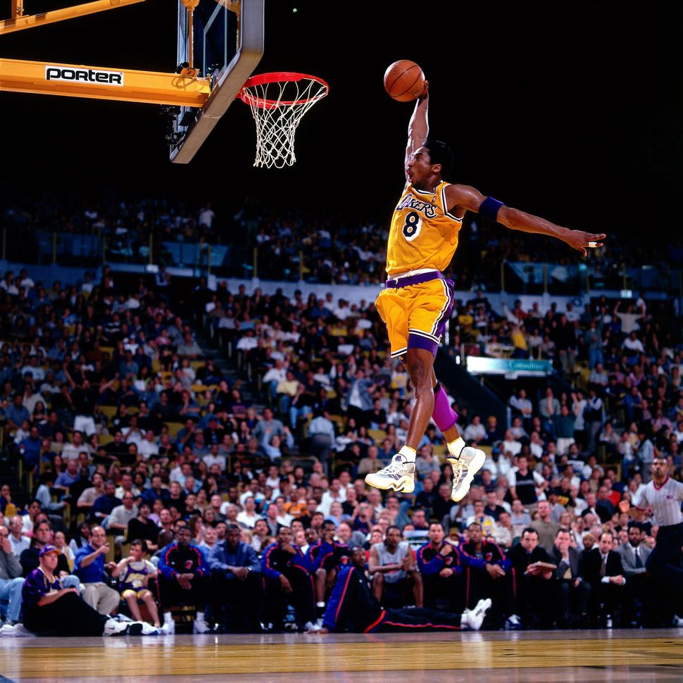 Bryant elevates for a dunk at the Great Western Forum in Inglewood, California, in the spring of his third season with t