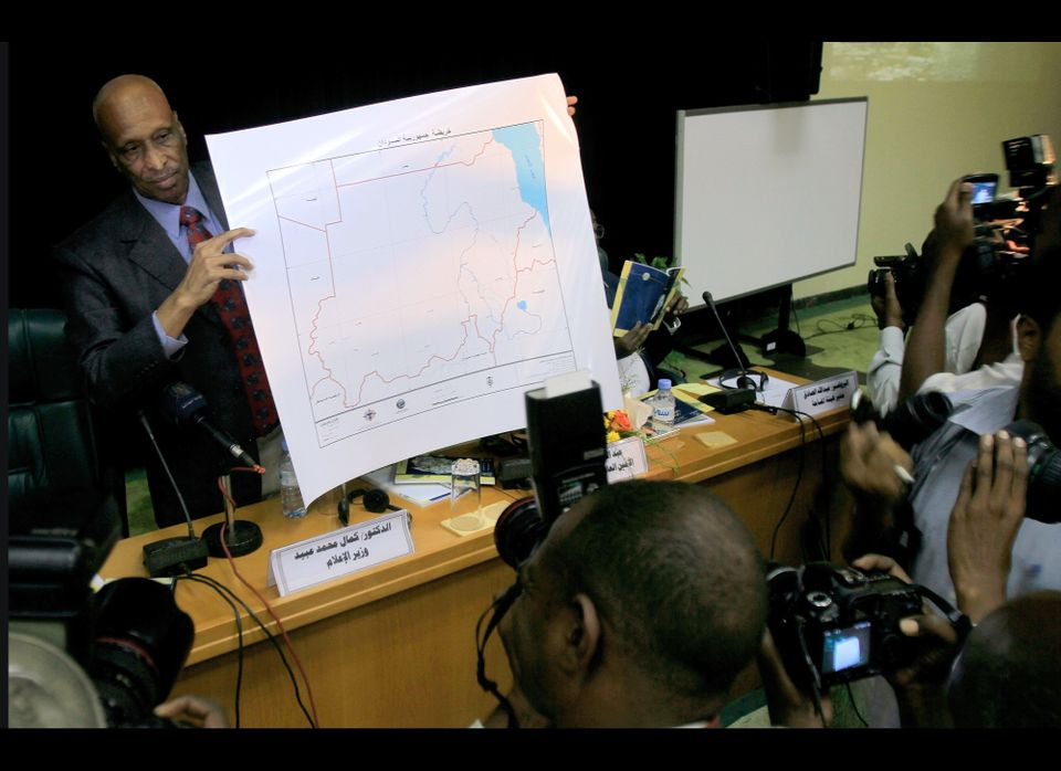 Sudanese Minister of Information Kamal Mohammed Obeid unveils in front of journalists the new map of Sudan in Khartoum on Jul