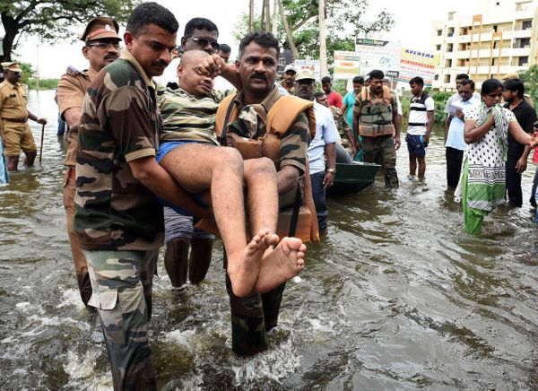 Indian Army personnel rescue flood-affected people during their relief operations in rain-hit areas on the outskirts of Chenn