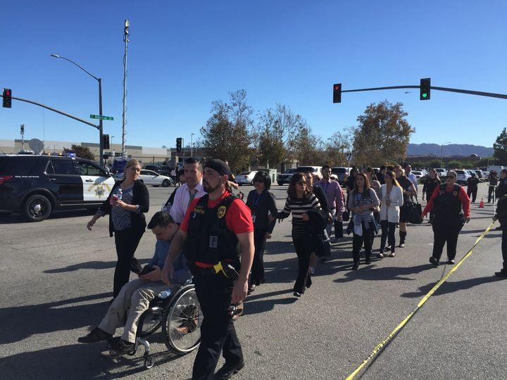 People are evacuated away from the shooting scene in San Bernardino, California, on Wednesday.