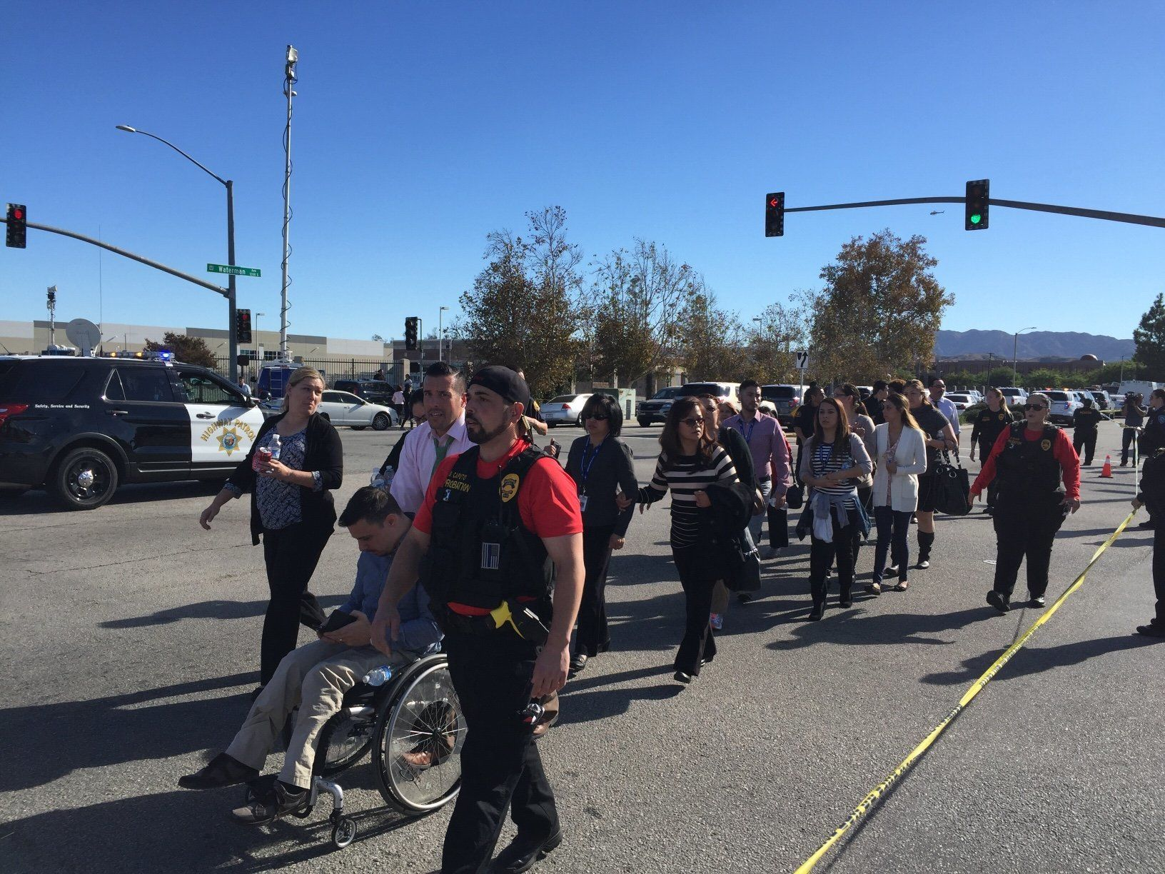 People are evacuated away from the shooting scene in San Bernardino, California, on Wednesday.