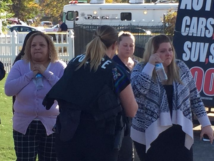 Employees of the Inland Regional Center outside the shooting scene in San Bernardino, California, on Wednesday.