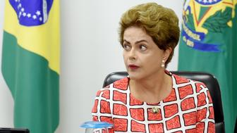 Brazilian President Dilma Rousseff attends a meeting at Planalto Palace in Brasilia on November 27, 2015 to discuss the situation of the dam burst in Mariana, Minas Gerais state. Rousseff will attend the UN Climate Conference - COP21 - in Paris, France which begins on November 30th. AFP PHOTO/EVARISTO SA / AFP / EVARISTO SA        (Photo credit should read EVARISTO SA/AFP/Getty Images)