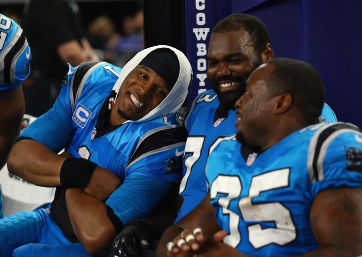 Panthers quarterback Cam Newton (left) and teammates Michael Oher and Mike Tolbert enjoy a 33-14 win over the Dallas Cowboys