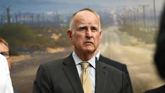 California Gov. Jerry Brown attends the  Drive The Dream 2015, an event aimed at accelerating the continued adoption of plug-in electric vehicles in California, October 15, 2015, in Los Angeles.   AFP PHOTO / ROBYN BECK        (Photo credit should read ROBYN BECK/AFP/Getty Images)
