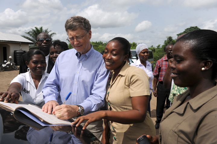Microsoft's chairman Bill Gates, one of world's richest man and high profile aid donors, signs visitor's register at the Ahen
