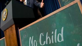 President George W. Bush marks the anniversary of his No Child Left Behind law during a visit with students, teachers and national educators at the General Philip Kearny School in Philadelphia, Thursday, Jan. 8, 2009. (AP Photo/J. Scott Applewhite)