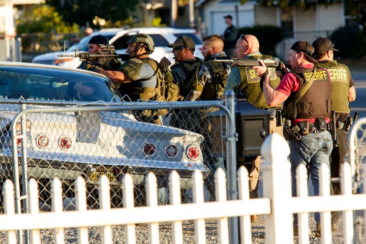 Law enforcement officers search for suspects following the mass shooting in San Bernardino on December 2, 2015. Two susp