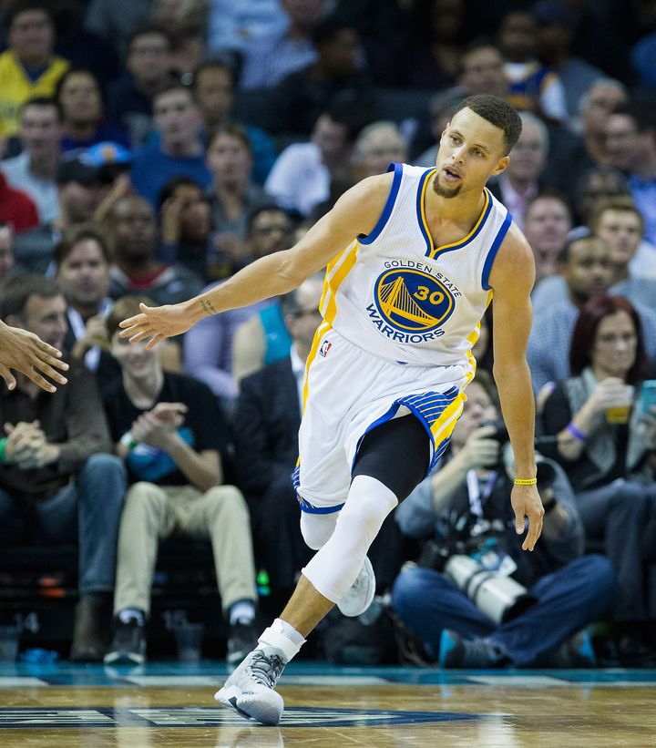Curry celebrates after scoring a second-half basket during Wednesday's gameagainst the Charlotte Hornets.