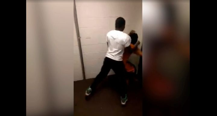 One of the two menis seen punching the 23-year-old victim, who has cerebral palsy, a neurological disorder which affect