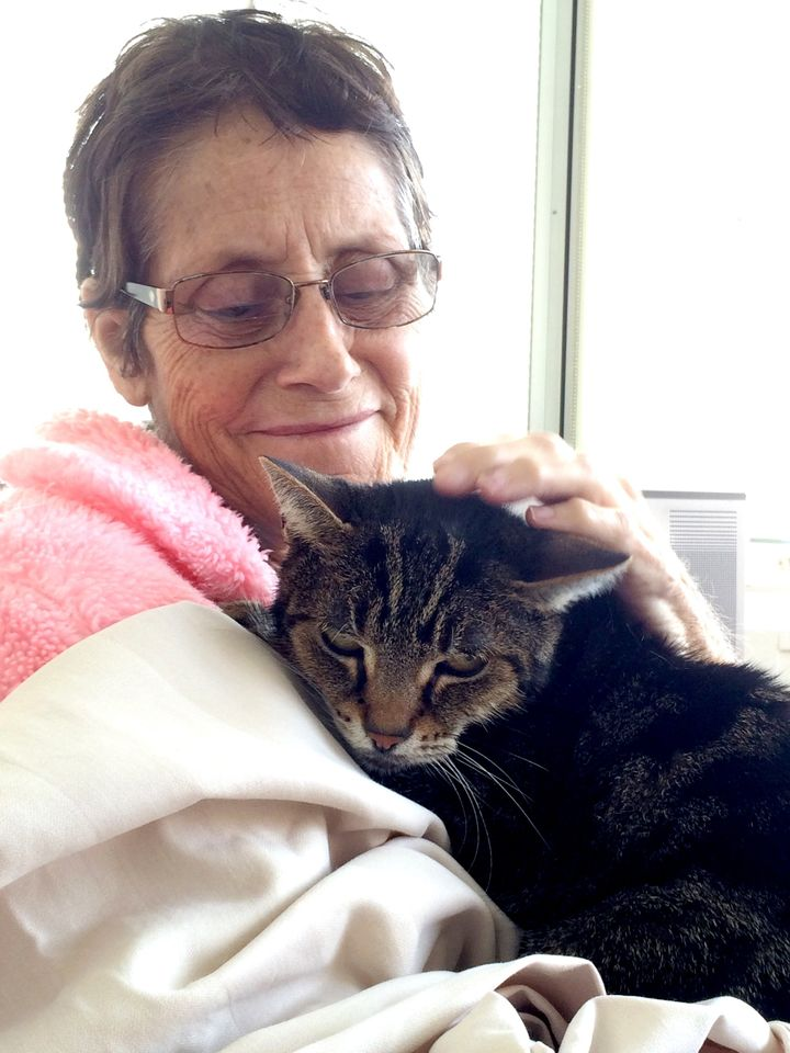 Grace Campbell with her tabby, Cuddles.