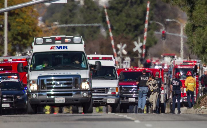 SAN BERNARDINO, CA - DECEMBER 2: Ambulances leave the scene of a mass shooting at the Inland Regional Center on December 2, 2